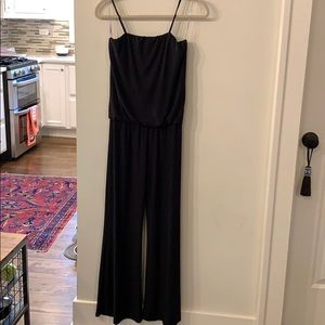 Black jumpsuit with spaghetti straps.
